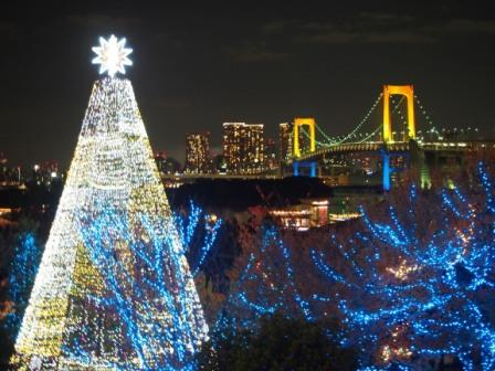 The big Christmas tree & Rainbow Bridge in Odaiba, Tokyo, Japan.